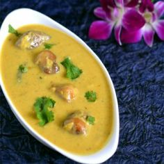 Kadhi Pakoda or kadhi chawal is popular North Indian side dish with rice made with besan (chickpeas flour), yogurt, spices & plan fritters.