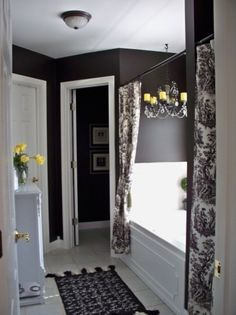 LOVE this black bathroom. Maybe for our new place since the bathroom will have a window in it for natural light.