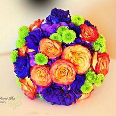 Purple and orange wedding bouquet.
