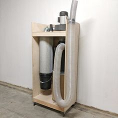 After months of researching, I finally decided to build my own dust collection system. This system is entirely bagless, and has been extremely efficient so far. I needed a system that had little footprint and high dust collection capacity. Woodworking Workshop Layout, Woodworking Projects, Wood Projects, Dust Collector Diy, Wood Pen Holder, Vinyl Record Holder, Shop Dust Collection, Hose Storage, Dust Extractor