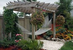 Image from http://www.francescagino.us/wp-content/uploads/2014/09/pergola-decorating-ideas-with-hanging-plants-and-climbing-plants-and-hammock.jpg.