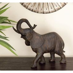 This gray standing elephant statue has a polystone construction, and depicts an elephant with its trunk raised dramatically. wide x deep x high. Standing elephant statue with trunk up. Style # at Lamps Plus. Stone Garden Statues, Outdoor Statues, Elephant Sculpture, Sculpture Art, Animal Sculptures, Expensive Art, Grey Elephant, Elephant Trunk Up, Elephant Table