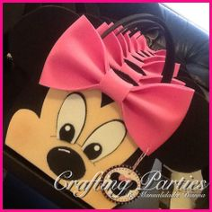 Minnie Mouse Pink Bow favor bag. Made completly out of EVA Foam, even the face. To see more of my handmade creations or for pricing information, visit my fan page at www.facebook.com/CraftingPartiesByDianna or on Instagram @craftingparties