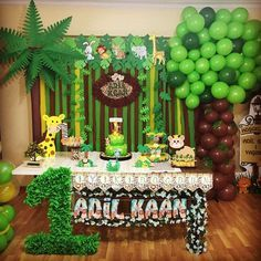 Image may contain: 2 people, indoor Safari Party, Safari Theme Birthday, Boys First Birthday Party Ideas, Jungle Theme Parties, Wild One Birthday Party, Safari Birthday Party, Boy Birthday Parties, Baby Birthday, Jungle Party