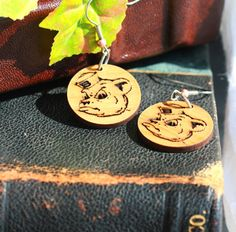 "$14.99 Show your Baylor pride with our Sailor Bear earrings! Made from alder wood, they are very light and comfortable to wear.  Hanging length approx 2"". Steel hardware.  Our collegiate products are Officially Licensed.  Items will ship 3-5 days after ordering.  https://www.etsy.com/shop/PeelioDesign?ref=hdr_shop_menu  https://www.facebook.com/peeliodesign/"