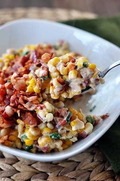 Creamy Confetti Corn With Bacon | 9 Thanksgiving Side Dishes With Bacon That Will Steal the Show, check it out at http://diyready.com/9-thanksgiving-side-dishes-with-bacon-that-will-steal-the-show