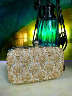 Victorian love! We absolutely love this Victorian era inspired white and gold, embroidered metal clutch! A must have ladies  Size: 16 x 5 x 10 cms Price: Rs 1100 For details of the products and to place an order, you can whatsapp on 9999968917, +34630292108 or email at veralikasingh@hotmail.com or maddy_rawat@hotmail.com.