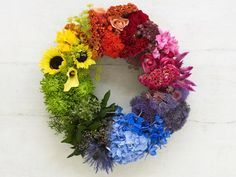 Welcome love into your home with a rainbow wreath! #lovewins >> http://www.hgtv.com/design/decorating/design-101/choosing-the-right-colors-for-your-arrangements?soc=pinterest