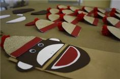 Sock Monkey Puppet Craft  - Paper lunch bag - Construction Paper (dark brown, white, red, gray) - Googily Eyes - Pom Pom