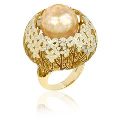 gold ring with enamelled #flowers and yellow and white #diamonds surrounding a faceted pearl