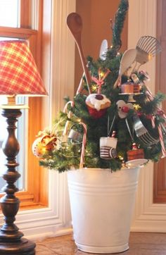 TABLE TOP HOLIDAY TREE WITH KITCHEN UTENSIL TRIMMINGS Credit: Aunt Ruthie's Sugar Pie Farmhouse