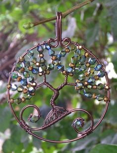 Green and Gold   by RachaelsWireGarden.  Variation on the typical tree of life pendant.