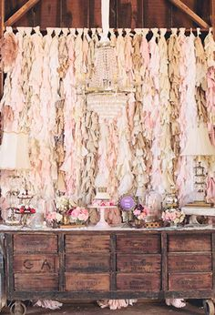 fringe fabric backdrop, rustic dessert table and dainty floral details
