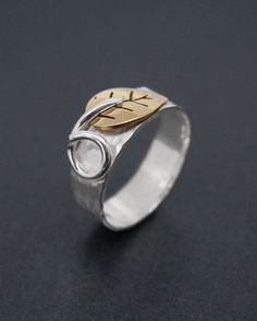 Silver ring with brass leaf                                                                                                                                                                                 More