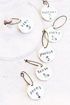 4736cd4a28c Custom Bridal Shower Wine Glass Charms also double as a seating name card!  A perfect