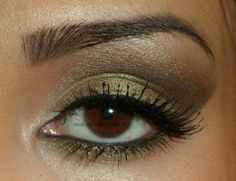 Mac Sumptuous Olive on lid with a brown in crease. Wearable day look for fall.