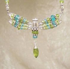 FAIRYs POOL II - Dragonfly Necklace in Peridot, Apatite, and  Sterling Silver. $253.00, via Etsy.