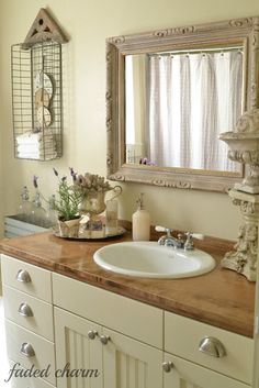 bathroom -- Nice and feminine...not too stark white-softness and nice natural light