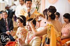 haircut during mid ceremony. Officiants, friends and relatives take turn [pretending] to cut couple's hair.