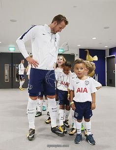 LONDON, ENGLAND - AUGUST 27: Harry Kane of Tottenham Hotspur with mascots prior to the Premier League match between Tottenham Hotspur and Burnley at Wembley Stadium on August 27, 2017 in London, England