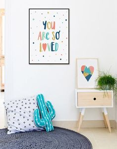 Check out the play of bold colors in this room. Perfect nook for kids to play and rest. Notice the bold typography framed.  #forkids #kidsroom #homedecor