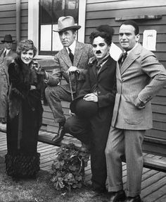 Charlie Chaplin, Mary Pickford, Douglas Fairbanks, and D.W. Griffith on the day they formed the United Artists corporation on Feb 5, 1919.