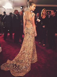 gold and beaded and cool cut out back