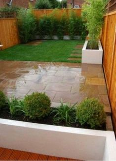 Extend pavers or concrete into yard a few feet