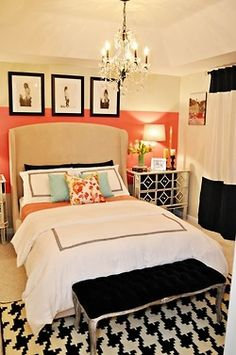 Master Bedroom: Black and White Bedding. Dark Grey Curtains. Coral and Sky Blue Accents. Light Grey Paint on Walls. Accent Tray Ceiling with Darker Grey Paint and Chandelier. DIY Upholstered/Tufted Headboard.