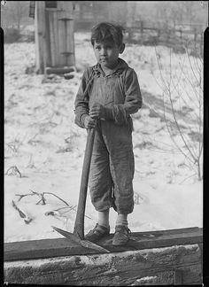 Scotts' Run, West Virginia. Miner's child digging coal from mine refuse. Bertha…