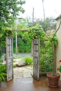 I love the idea of having random doors in your garden, like you're entering another world.