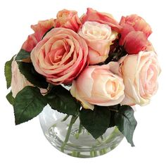 Bring a romantic touch to your dining table or nightstand with this lovely faux rose arrangement, showcasing an array of lush blooms in a bubble vase.