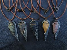Pretty and useful; flint and steel pendants.