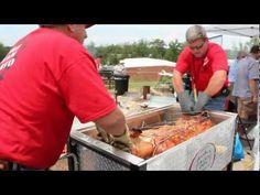 Roasting a whole pig in a La Caja China Roasting Box