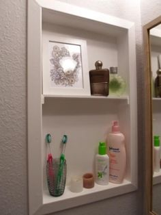 Ugly Medicine Cabinet Turned Cute Shelf- something to do with those dumb extra medicine cabinets in every bathroom in this house!