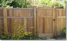 Red Cedar Fence. 6' Cap Top Fence with 2x6 rot board, 2x6 Cedar Cap with 1x4 Cedar Trim
