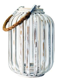 Nautically inspired and hand crafted from bamboo and rope, our Moana Bamboo White Lantern will bring an island feel to your home. This chic lantern will add a pretty glow to your patio, family room or bedroom.