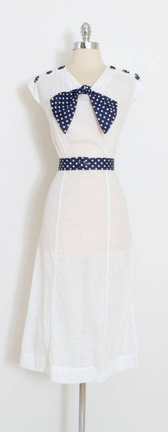 ➳ vintage 1930s dress * adorable nautical inspired cutie * white textured cotton * the coolest square fabric covered metal buttons * polka dot necktie and belt * no back or side closure - pulls on condition | excellent fits like xs/s length 48 bodice 18 bust 36-38 waist 30-31 (unbelted) hips 36-38 ➳ shop http://www.etsy.com/shop/millstreetvintage?ref=si_shop ➳ shop policies http://www.etsy.com/shop/millstreetvintage/policy twitter | ...