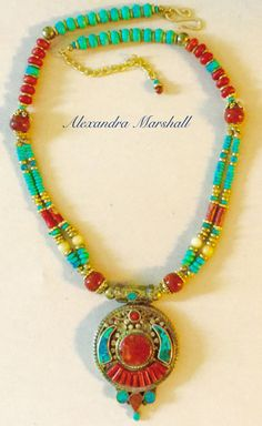 """""""Song of Tibet"""" Tibetan Bronze Amulet Necklace inlaid with Coral and Turquoise mosaic by Alexandra Marshall. This one was custom made for Gerre, but we can fabricate a similar piece especially for you."""
