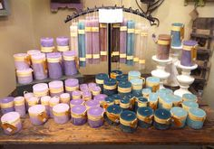 Lavender, lilac, teal, and sea glass. The purples are for meditation, contemplation, mystery and spirituality. Sea glass is cool, soothing, dreamy and magical. Teal supports renewal, innovation, alternative ways of living together. Vance Kitira candles available at Mountain Lights in Asheville!