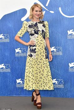 Dressed to impress: The mother-of-two wowed as she arrived in a yellow, blue and white dress