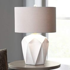 An embossed geometric pattern adds contemporary appeal to this glossy white ceramic table lamp from Uttermost. Style # at Lamps Plus. Cool Lamps, Cool Floor Lamps, Halogen Lamp, Contemporary Table Lamps, Ceramic Table Lamps, Bedroom Lamps, Lamp Design, White Ceramics, Appliques