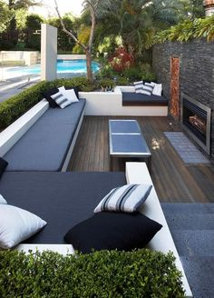 A very inviting and comfortable patio, conveniently placed by the pool