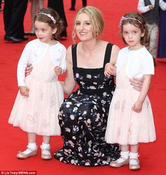 Pretty in pink: Laura Carmichael kept a tight hold of her young co-stars, who take turns to play Lady Edith's daughter Marigold