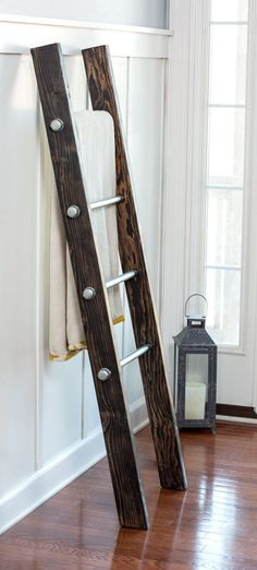 Industrial decor meets rustic farmhouse with a twist. This wood ladder is designed to appear as reclaimed wood yet it looks sophisticated and sleek