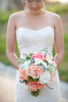 beautiful peach, stormy blue and white wedding bouquet