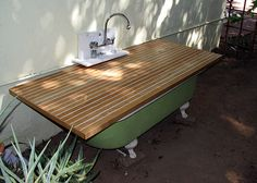 Outdoor Bath Tub Cover:  I love outdoor garden tubs.... some bed and breakfasts have these :) I like the site 'vacation rentals by owner' 'vrbo' it's nationwide and world wide, and you can do a keyword search like 'outdoor tub'