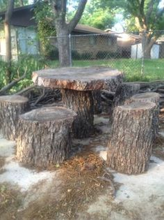 DIY Tree Stump Table Ideas & How to Make Them table and chairs made out of tree stumps.