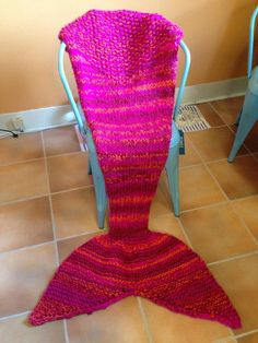 This Mermaid Knitted Sack Blanket may be one of the cutest and most interesting knit blanket patterns out there. Using bright pink bulky yarn, this knit blanket is actually a sack so you can slip your legs in and stay cozy while feeling like a mermaid. How cool is that? This mermaid blanket pattern would also be perfect for a daughter or granddaughter. Just imagine the look of excitement on her face when she sees her new knit mermaid blanket. So, if you want to be the coolest relative…