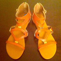 Rock & Candy by Zigi Gladiator Sandals Authentic Rock & Candy by Zigi Gladiator Sandals. Tan with Gold accents. Back Zippers. Side Strap on each outer side near the Ankle. Synthetic Upper. Balance Man Made. Brand New. Excellent Condition. No Trades. Rock & Candy by Zigi Shoes Sandals